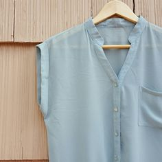 """Gray Blue Green Sheer Tie Front Blouse Button Up A beautiful sheer top with tie front and monochromatic pearlized buttons. Tag is missing, but fits like medium. Sharp shirt in gorgeous color! Bust approx 36-38"""". Tops Blouses"""