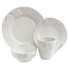 Offering charming appeal for your dining table, this lovely earthenware dinnerware set showcases scrolling fruit details and a white finish.