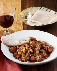 Ethiopian Spiced Lamb Stew with Injera (GF flatbread) and Cabbage and Carrots with Turmeric from Food & Wine magazine