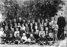 St. Alyosius School  1904 Students and Father Calavia pose in front of St. Alyosius School