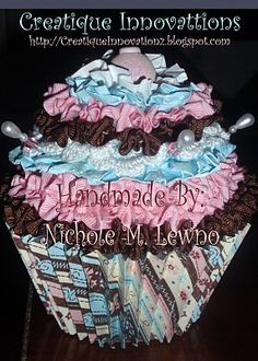 Cupcakes...I LOVE paper cupcakes the kind you can eat!  Handmade via Fabulously Artsy online video tutorial.
