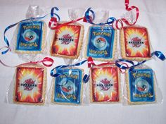"""Pinner Says: Just some quick cookies for the cub scout bake sale. My son thought pokemon and bakugan cards would be popular so I scanned a card and printed them out on icing paper. the cookies are small about 2""""x2 1/2"""". NFSC, ri border."""