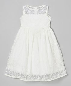 Just a quick zip up the back and any little lady will look most fabulous in this endearing dress. A blossom-embellished satin waistband, silky lining and lacy overlay ensure it will shine on any occasion.