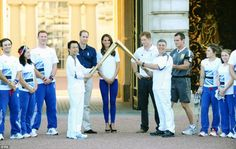 Duke and Duchess of Cambridge with  Prince Harry   welcomed the Olympic torch relay at the  Buckingham Palace