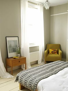 Greige bedroom: Neutral paint color + chartreuse chair | by SarahKaron