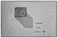 """GianfrancoChiavacci """"Cubino"""", 1996. Foglio di alluminio uso cucina di misure binarie, compresso in un cubo di cm 1,5x1,5."""