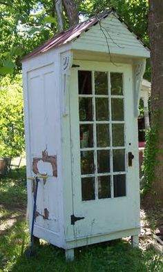 This tiny little shed is so precious. It looks to be made completely from vintage items.  Reminds one of an old telephone booth. Love!!  http://faithandpearl.blogspot.com/2011/08/what-makes-garden-shed-shed.html