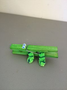 "Playgroup alligator craft made by green peg (colour natural peg by soaking in boiling water with tablespoon vinegar and food dye for a couple of hours) with 2 x 1/3 pieces of pipe cleaner doubled and bent in ""u"" shape. Claw front legs into peg. Glue back legs in and glue eyes on."