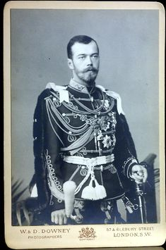 A fine and rare antique cabinet photograph of Czarevich Nicholas (later czar Nicholas II) wearing the uniform of British hussars and chain of the order of the Garter,  by London photographers W & D. Downey.