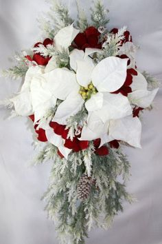 poinsettia bouquet idea for the end of the pews in the chapel...