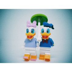 咱二人做阵拿着一支小雨伞 雨越大我来照顾你你来照顾我  #OneSmallUmbrella #DonaldDuck #Diasy DonaldAndDaisy #Disney #Lego #Legostagram #LegoPhotography #MiniFigures #LegoMiniFigures  #HarryewToyStory #HarryewPhotography#Instagram #InstaToys #InstaLego #vscoCam #vscoSG #Singapore #Hashtags by harryew79