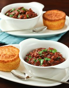 Beer Chili by Sommer: Made with beef, sausage, masa (corn flour), ancho chile powder, cumin, onion, oregano, red pepper, onion, garlic brown sugar, canned tomatoes, beans and a bottle of beer, this looks so good. Serve it with Maple-Bacon Corn Muffins or Jamaican Johnny Cakes! #Beer_Chili #Chili #Sommer