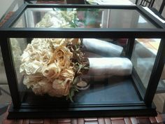 wedding bouquet display case - using a football display case