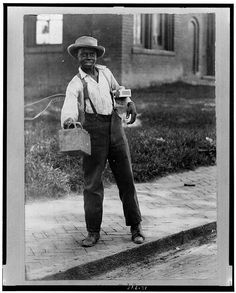 African American Boy African American boy holding out shoe shine box. ca. 1899 Vintage African American photography courtesy of Black History Album, The Way We Were.