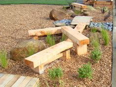 Balancing beams that double as benches. Low enough to be safe whilst still allowing children some form of risk