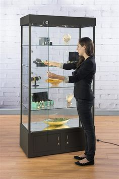 Display Case w/ 9 LED Lights, Mirror Bottom, Enclosed Cabinet, Locking - Black Boutique Interior, Pantry Cabinet Home Depot, Modern Tv Room, Glass Curio Cabinets, Cool Retail, Glass Display Case, Mirrored Furniture, Hobby Room, Furniture Showroom