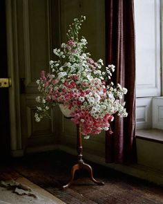 Photography by Tim Walker.. I love the flow of this arrangement