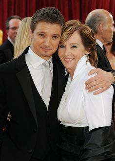 Renner and his mom.  - 82nd Annual Academy Awards. wanted to put this in my 'let me lick you' folder but wasn't sure his mummy would approve....