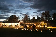 Direct your guests with lighted luminary pathways for an evening wedding