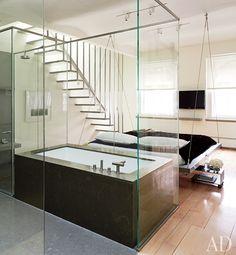Glass enclosed bathroom with limestone tub screams I'm Bringin' Sexy Back!-Reynolds Still