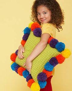 Bernat Super Value - Pompom-Edged Pillow (free crochet pattern)