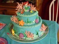 Little Mermaid Birthday - Little Mermaid cake (inspired by many cakes on this site :-), decorated in buttercream and tinted-chocolate accents. Shells were made from molds and coral was hand-piped. Ariel is a candle, Sebastian & Flounder are little figurines.
