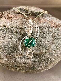 Green Zircon design created by jewelry designer, Ginny Powers of Ohio. Made with fine silver metal and the stone is about 6 carats. Jewelry Designer, Silver Metal, Sculpting, Ohio, Pendant Necklace, Gemstones, Green, Handmade, Sculpture
