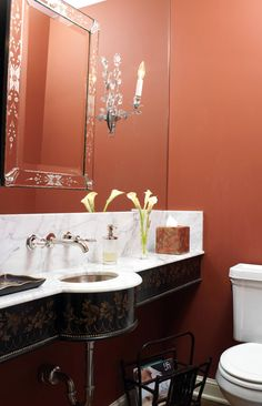 Decorating: Bath Vanities A hall closet in a Minneapolis home was converted into this jewel of a powder room, featuring a vanity front custom painted to resemble an antique lacquered tray. The vanity was left open below and faucets were mounted on the wall to save space in the 3-1/2x5-foot room.