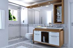 Fotos de banheiros Planejados com armários de madeira marrom e branco: Mais