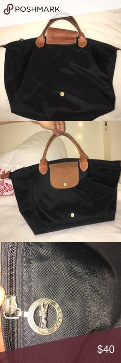 Longchamp black tote Black longchamp bag. Authentic! Got some uses out of it. Does not have any rips or holes. Handles are short. I think it is a medium size bag. Has enough space to fit books and maybe a small MacBook or laptop. Longchamp Bags Totes