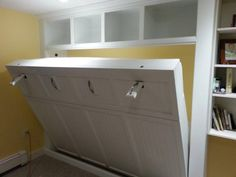 Custom built-in pull down queen size Murphy bed for a basement office. Unit was designed to fit in a tight space between an existing bookcas...