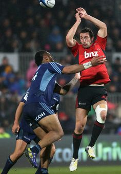 Tom Taylor of the Crusaders competes in the air for the ball with Frank Halai of the Blues during the round 14 Super Rugby match between the Crusaders and the Blues at AMI Stadium on May 18, 2013 in Christchurch, New Zealand.