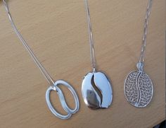 Brand new necklaces in stock today!  Be the first to purchase these delightful pieces of jewellery in Silver.  Perfect for all coffee lovers or as a gift for a loved one.  COFFEE GRAIN SHAPED PENDANT WITH FILIGREE € 38.00  COFFEE GRAIN EDGE PENDANT € 45.00  STYLIZED GIANT COFFEE GRAIN € 47.00  Available at #WOCNICE2013 and to order now from sales@scae.com Coffee Grain, Diy Jewelry Inspiration, Coffee Art, Coffee Lovers, Curiosity, Caffeine, Silver Necklaces, Filigree, Washer Necklace