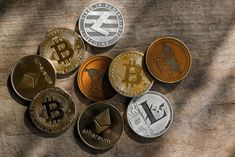 Family of cryptocurrency. Stack of shining golden and silver coins with sunlight on wooden background. Ripple and litecoin dominance, Warm colours - photo of crypto coins. Token Economy, Buy Cryptocurrency, Blockchain Cryptocurrency, Cryptocurrency Trading, Crypto Money, What Is Bitcoin Mining, Crypto Market, Central Bank, Dollar