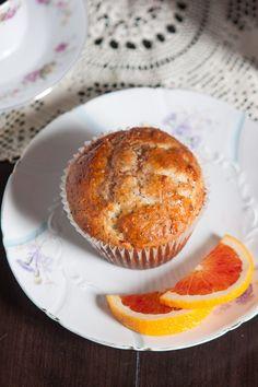 Simple bakery-style jumbo orange poppy seed muffins.
