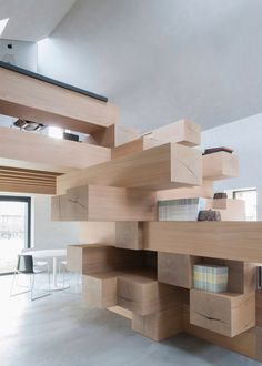 Studio Farris Architects has integrated an office into a staircase made from stacked timber beams, and installed it inside a renovated barn in West Flanders, Belgium