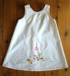 Toddler dress out of embroidered dish towel. Holy cuteness!