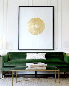 Green sofa with art. #Emerald #Decor #Style