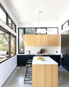 I love the preference of windows over storage in this minimal contemporary kitchen