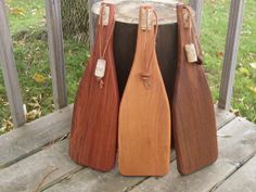 Cheese boards in the shape of wine bottles with leather strap for wall hanging