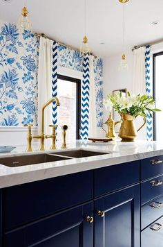 Navy Blue Kitchen Cabinets + Blue & White Floral Wallpaper + White Marble Counter Tops + Brass Accents
