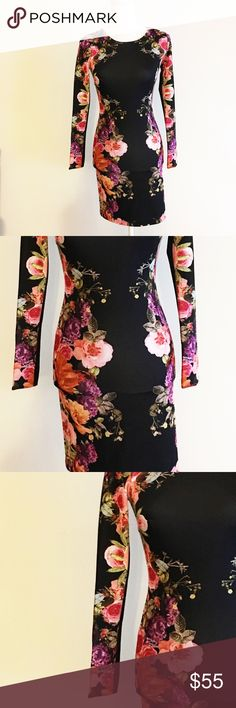 Beautiful form fitting floral long sleeve dress This dress is absolutely stunning!! Price tag on for over 100. Great deal, fabulous dress. Dresses Long Sleeve