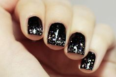 Black nails with glitter.