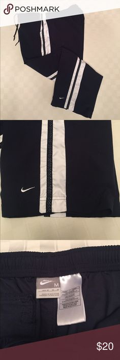 LIKE NEW NIKE CAPRI Like new, great workout, lounge and relax pants.  100% polyester, navy with white stripe. Smoke free home. Nike Pants Capris
