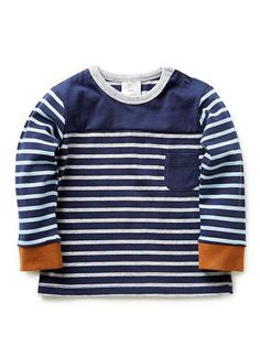 100% cotton rugby long sleeve tee with front chest pocket and contrast striped sleeves.Features contrast rib cuff and snap closure at side neck
