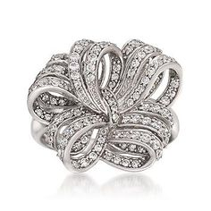 Our ribbon ring embellished with CZs wrapped into a deluxe double bow. Sterling silver ring. >>Just click the CZ fashion ring to see more styles like this at Ross-Simons.