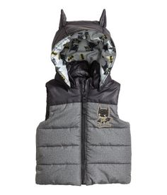 Padded vest with front zip and appliqué at front. Detachable lined hood with attached ears. Patterned lining. #Batman