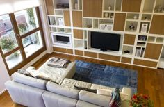 Cool Modern Residence With Practically Organized Interiors With White Sofa And Wooden Cabinet Design