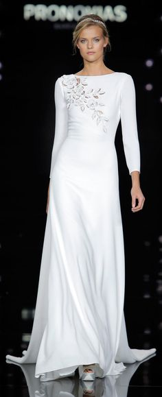"""Atelier Pronovias Spring 2017  Closed out Barcelona Bridal Fashion Week with a gorgeous collection of weightless gowns inspired by """"La Ciel"""" or, the sky. Wispy feathers, floral appliqué and flowing capes gave sleek silhouettes a touch of ethereal texture"""
