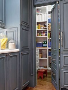 Hidden Walk-In Pantry  Disguised behind a hideaway door made to resemble kitchen cabinetry, this walk-in pantry design presents an abundance of food storage. Open floor-to-ceiling shelves offer a quick view of what's in stock. A countertop located just outside the pantry serves as a designated prep area and place to set down supplies.